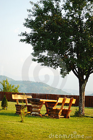 The Beatiful place, green meadow and bench on