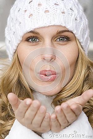 Beatiful woman blowing kiss
