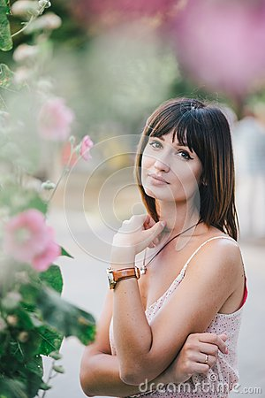 Free Beatiful Woman In A Pink Dress Posing Near Pink Flowers Royalty Free Stock Images - 42923989