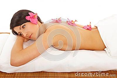 Beatutiful Woman Relaxing Spa with Flowers