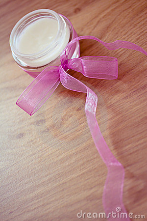 Beaty lotion with pink ribbon