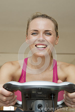 Beautful young woman on exercise machine