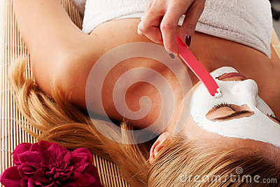 Beautician applying a face mask