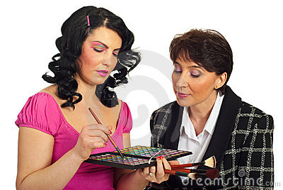 Beautician discuss with mature model
