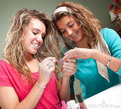 Free Beautician Painting Girls Nails Royalty Free Stock Photo - 21677995