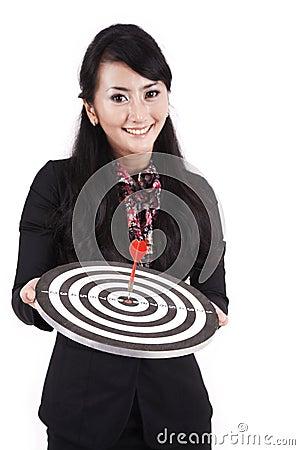 Beautidul businesswoman holding dartboard
