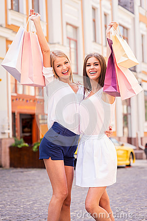 Beauties with shopping bags.