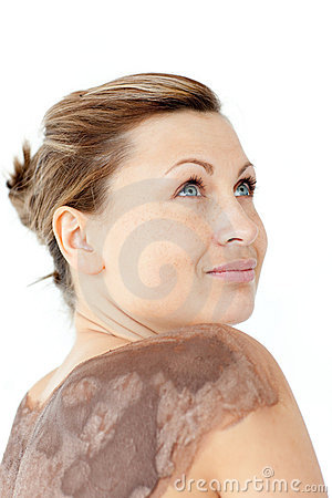 Beautifl woman with mud on her back