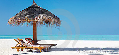Beautifu beach with chairs and umbrella