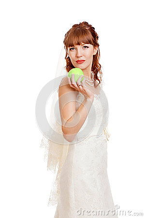 Beautifu  bride holding apple.