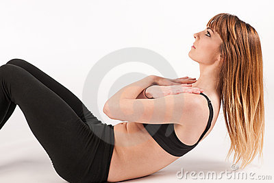 Beautiful active woman doing situps