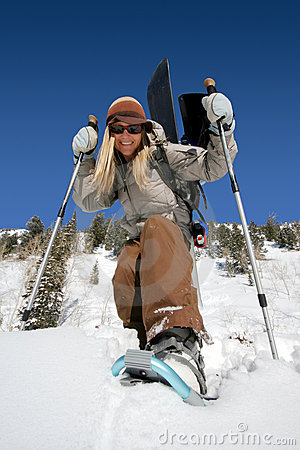 Free Beautiful Active Woman With Snowshoes And Snowboard Royalty Free Stock Photography - 1794517