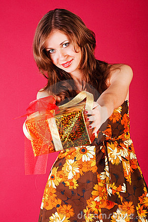 Beautiful adorable young girl with a present