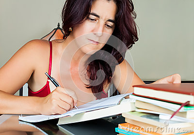 Beautiful adult hispanic woman studying