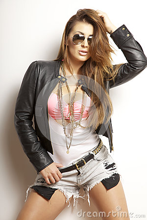 Beautiful adult sensuality woman in black jacket and sunglasses