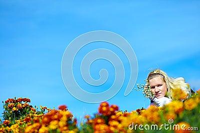 Beautiful adult teen among yellow flowers