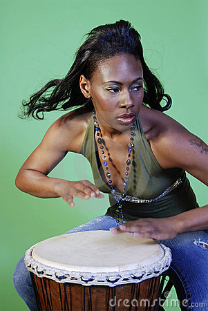 Beautiful African-American woman playing drums