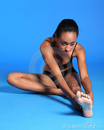Beautiful African fitness woman hamstring stretch