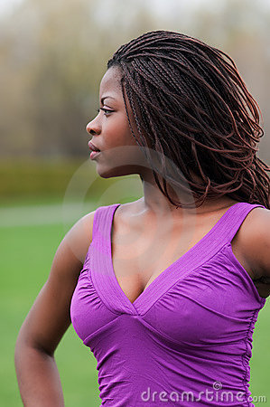 Beautiful african woman outdoors in profile