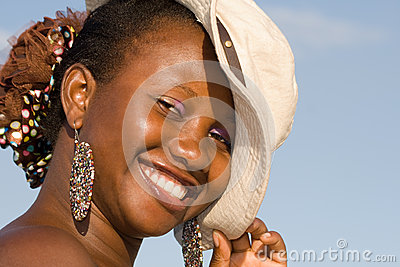 Beautiful african woman wearing a hat