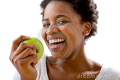 Beautiful African women eating an apple