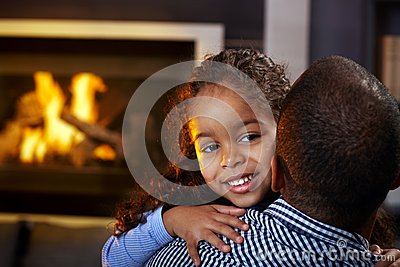 Beautiful afro little girl hugging father smiling