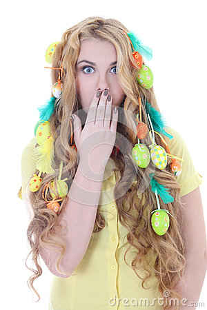 Beautiful amazed woman with long hair and easter eggs