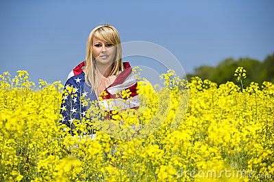 A beautiful with american flag in yellow field