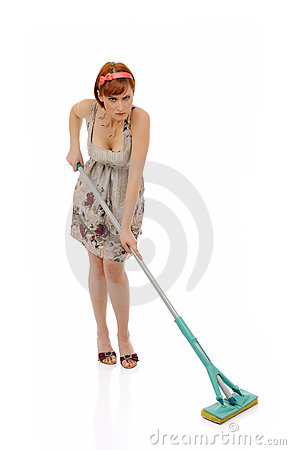 Beautiful angry house woman cleaning the floor