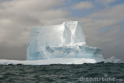 Antarctic iceberg with zodiac in front