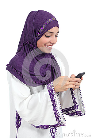 Beautiful arab woman browsing her smart phone