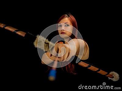 Beautiful archery woman aiming, black background Stock Photo