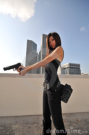 Beautiful Asian Agent/ Killer standing on the roof