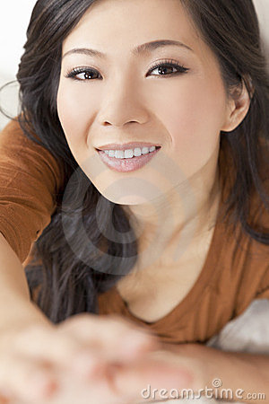 Beautiful Asian Chinese Woman Reaching To Camera
