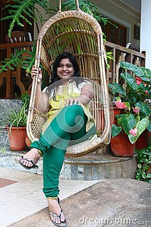 Beautiful Asian Girl in Bamboo Swing Chair