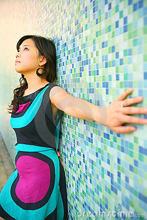 Beautiful Asian Girl Lean Back On Blue Wall