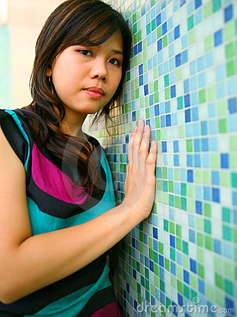 Beautiful Asian Girl Lean Blue Wall