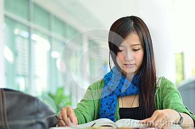 Beautiful asian girl is reading
