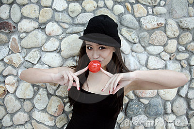 Beautiful Asian girl with a red ball