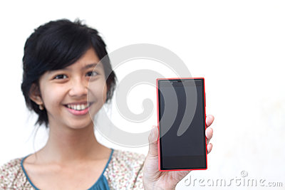 Beautiful asian girl showing her smartphone