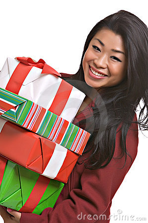 Beautiful Asian woman carries Christmas gifts