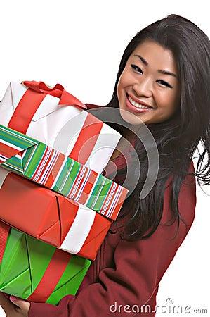 Beautiful Asian woman carries Christmas gifts