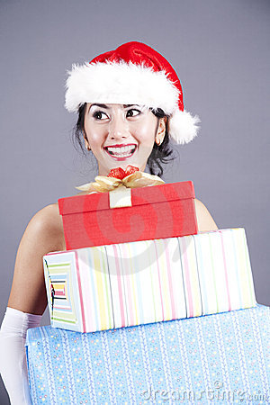 Beautiful Asian woman carrying christmas gifts