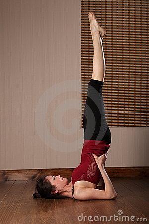 Beautiful Asian woman doing floor exercise