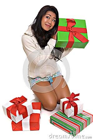 Free Beautiful Asian Woman Opening Christmas Presents Stock Photo - 6038560