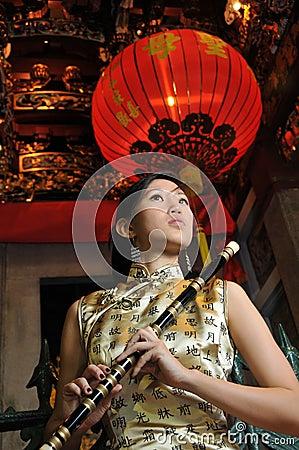 Beautiful Asian Woman In Oriental Theme.