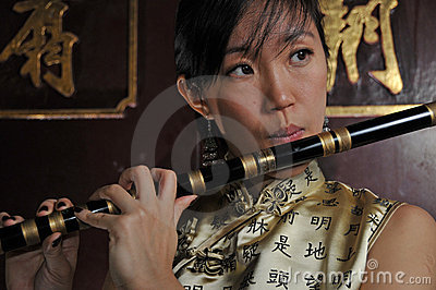 Beautiful Asian Woman Playing Flute