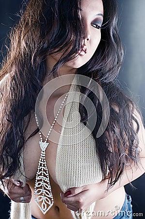 Beautiful asian woman portrait with jewel tie