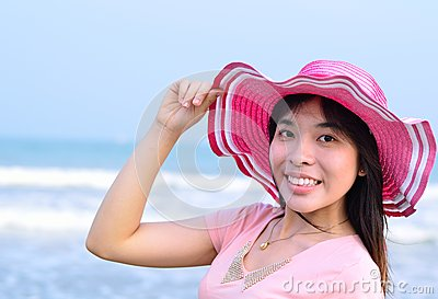 Beautiful asian woman relaxation on beach with hat