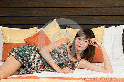 Beautiful Asian woman resting in bed